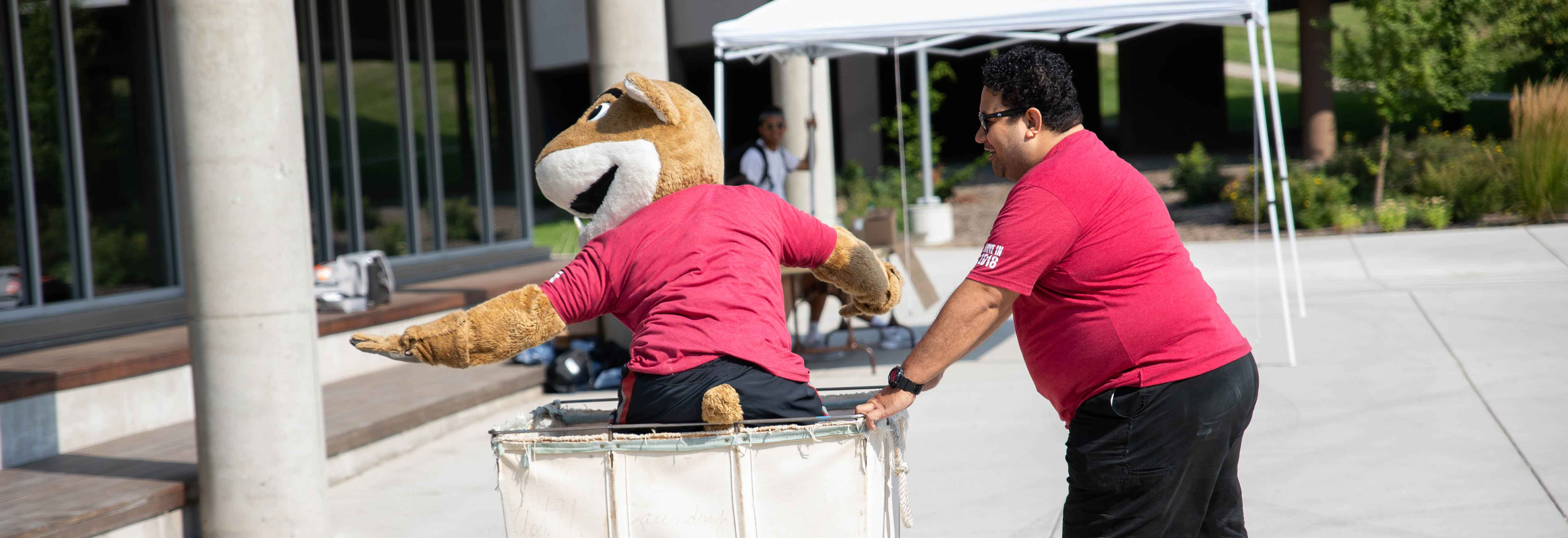 Butch Cougar mascot riding in cart